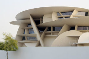 A part of the museum is in view with its interesting architecture that folds over one another like the desert rose.