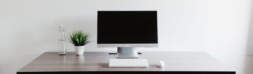 A computer on a desk