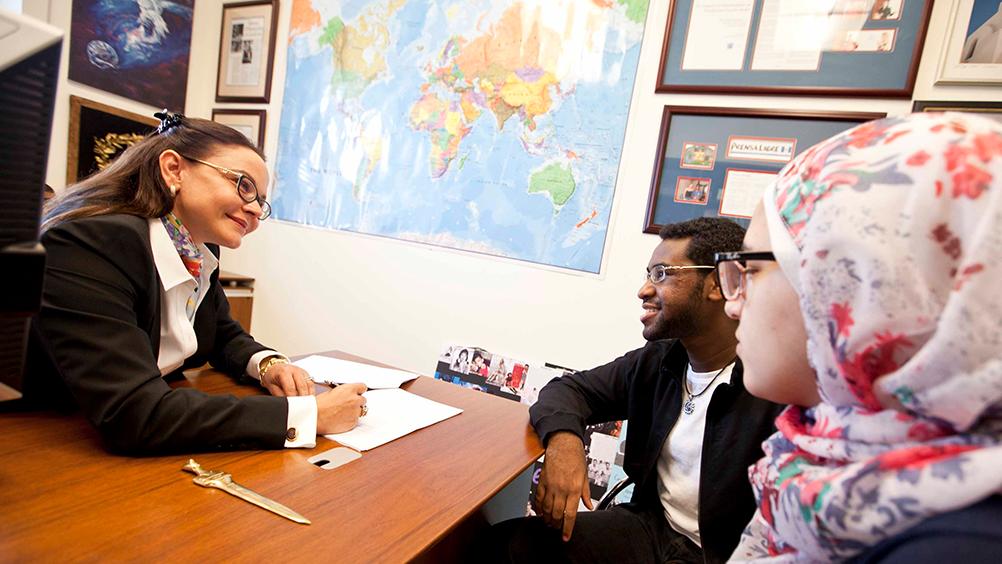 Academic dean advising students